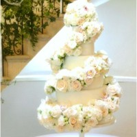 6-tier White Ivory Rose and Orchids Floral Cascade Spiral Wedding Cake for Eastington Park Manor House Gloucestershire Cherie Kelly London