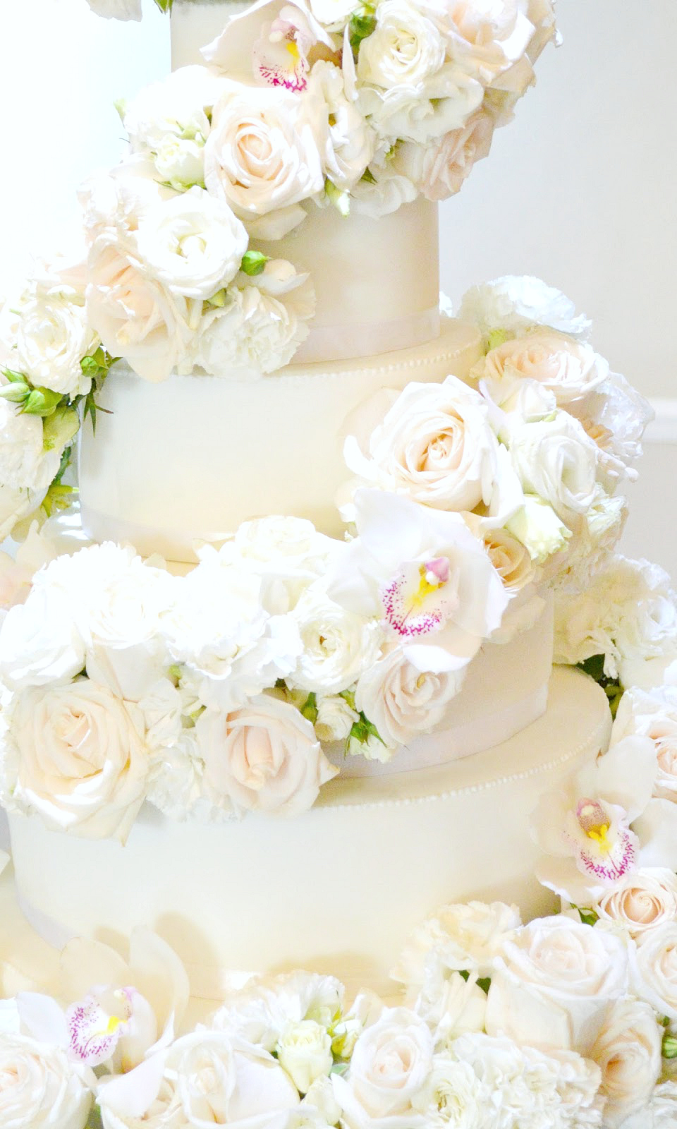 6 tier White Ivory Rose and Orchids Floral Cascade Spiral Wedding Cake Cherie Kelly London