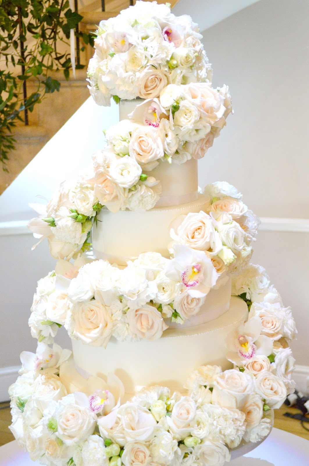 6-tier White Ivory Rose and Orchids Floral Cascade Spiral Wedding Cake for Eastington Park Manor House Gloucestershire Cherie Kelly London 1