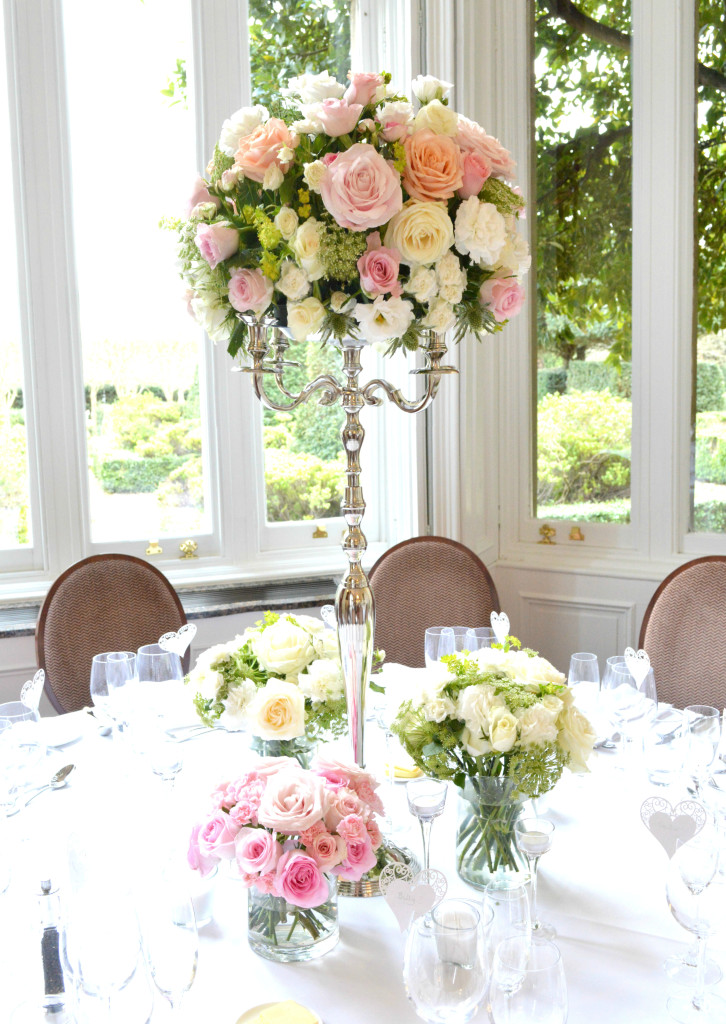 Cherie Kelly Fawsley Hall Wedding reception head table candelabra flower arrangements tall and low centrepieces