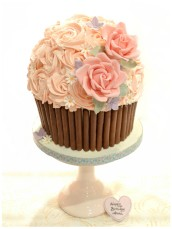 Giant Red Velvet Cupcake with Sugar Roses and Pink ButtercreamCherie Kelly Cake London