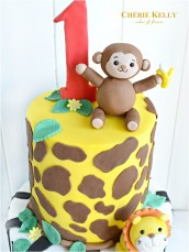 Jungle Safari Animal Monkey Lion Elephant Cake with Giraffe and Zebra Print One Year Old First Birthday Cake Party Cherie Kelly London