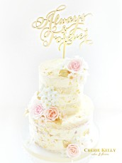 Naked Wedding Cake with Edible Gold Leaf, Pink Peach Blue Sugar Flowers Roses and Gold Calligraphy Cake Topper Cherie Kelly London