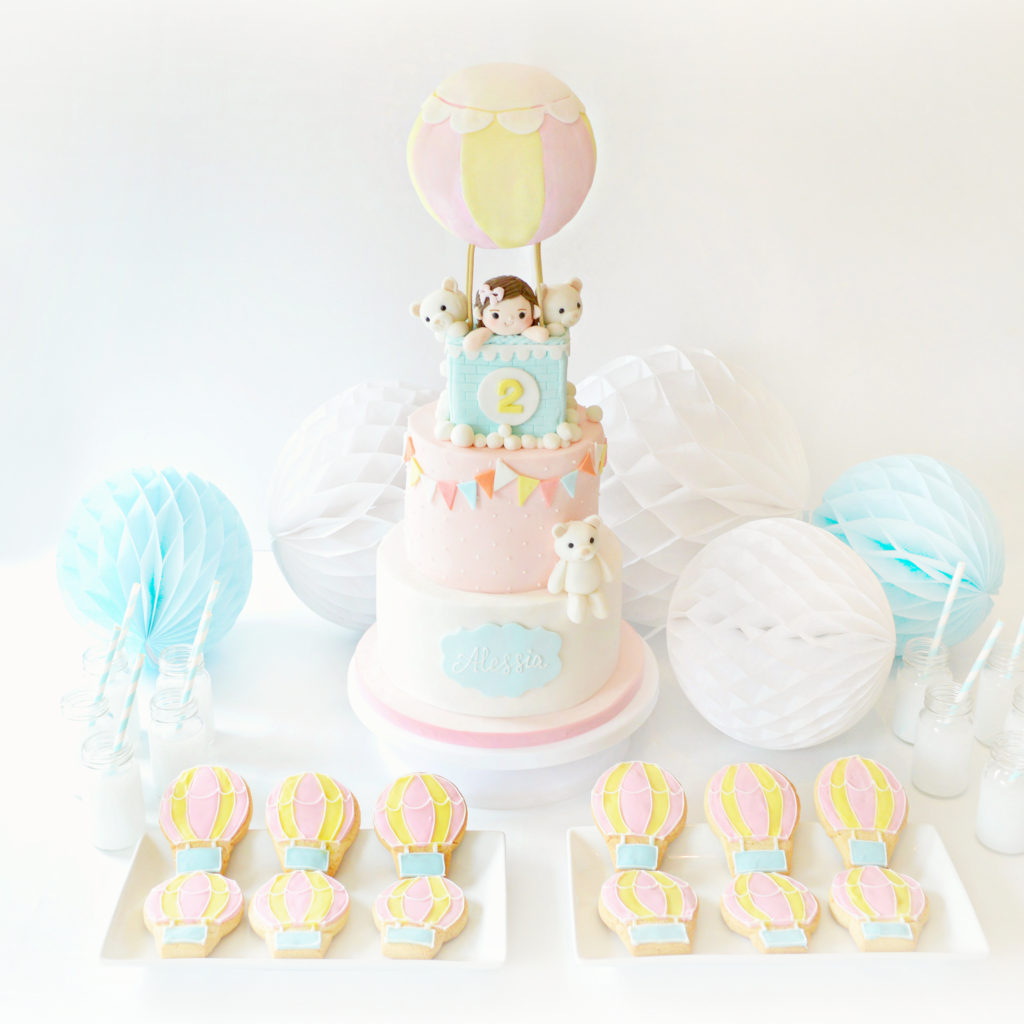 Pastel Pink, Yellow and Blue Hot Air Balloon Cake and Cookies Birthday Cake Table Cherie Kelly London