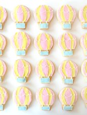 Pastel Pink, Yellow and Blue Hot Air Balloon Cookies Party Cake Table Cherie Kelly London