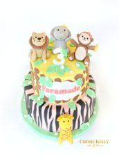 Pink Girl's Jungle Safari Animal Monkey Lion Elephant Giraffe Cake with Giraffe and Zebra Print Three Year Old Birthday Cake Cherie Kelly London