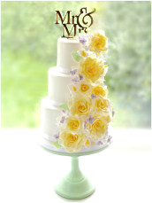 Sugar Calla Lily, Pastel Yellow Roses and Lilac Hydrangea Wedding Cake with Gold Mr and Mrs Cake Topper Cherie Kelly London