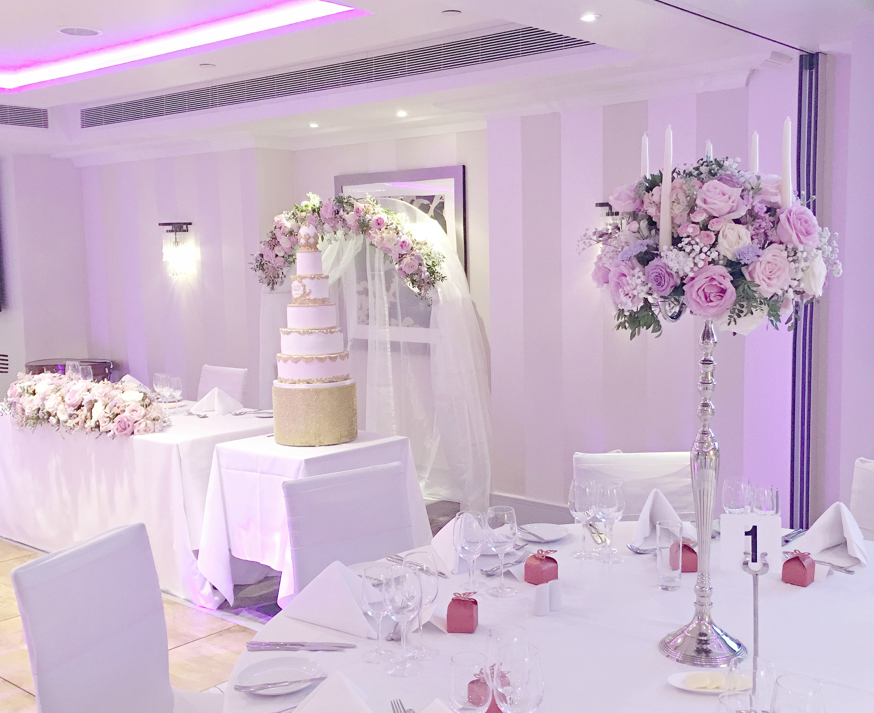 Pink And Lilac Wedding Head Table With Flower Arch Backdrop With