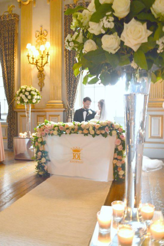 Wedding Registrar table flower arrangement flower garland Cherie Kelly Knowsley Hall