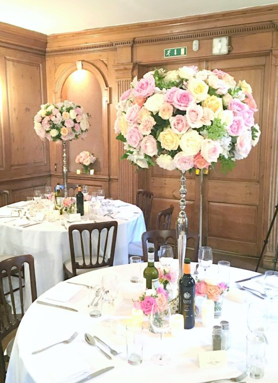 Coral, Peach and Pink Summer Wedding Flowers tall candelabra centrepieces and Cake Table in Burgh House Cherie Kelly London