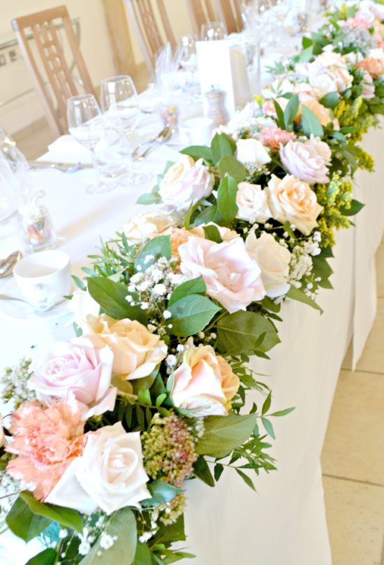 Rustic Orange and Peach Headtable Flower Garland Wedding Flowers Centrepiece at Rivervale Barn Hampshire Cherie Kelly