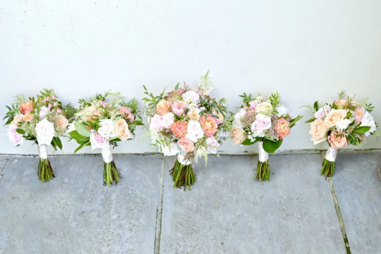 Rustic Orange and Peach Wedding Bridal Bouquet and Bridesmaids Bouquets at Rivervale Barn Hampshire Cherie Kelly