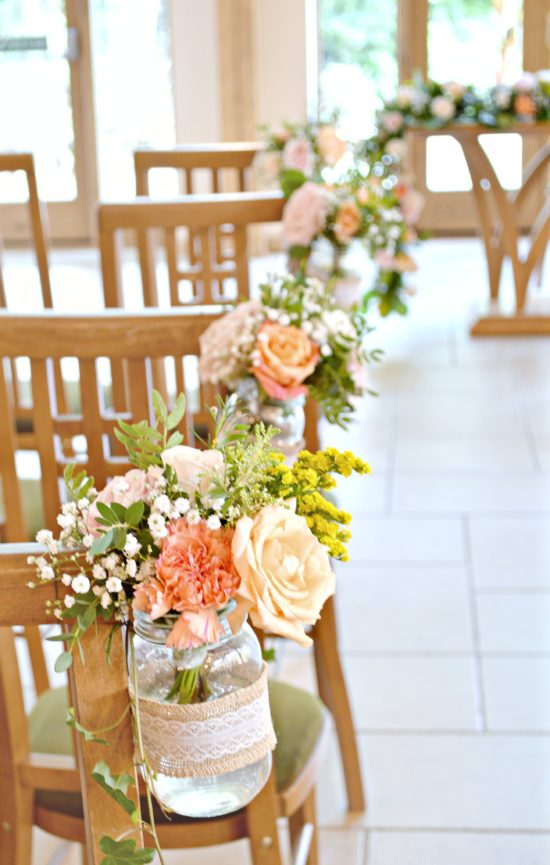 Rustic orange and peach wedding flowers and cake at rivervale barn rustic orange and peach wedding ceremony aisle flowers in jam jars at rivervale barn hampshire cherie junglespirit Images