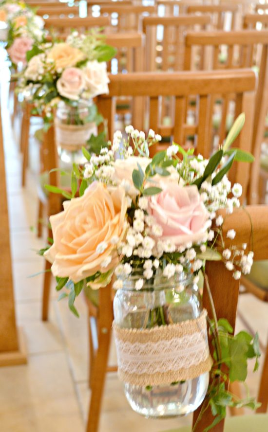 Rustic Orange and Peach Wedding Ceremony Aisle Flowers in Jam Jars at Rivervale Barn Hampshire Cherie Kelly