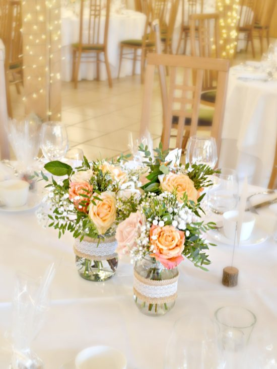Rustic Orange and Peach Wedding Reception Flowers in Jam Jars Centrepieces at Rivervale Barn Hampshire Cherie Kelly