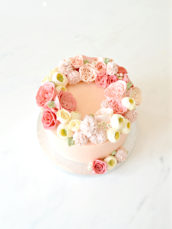 Millennial pink buttercream flowers David Austin garden roses pom pom ranunculus wreath cake Cherie Kelly London