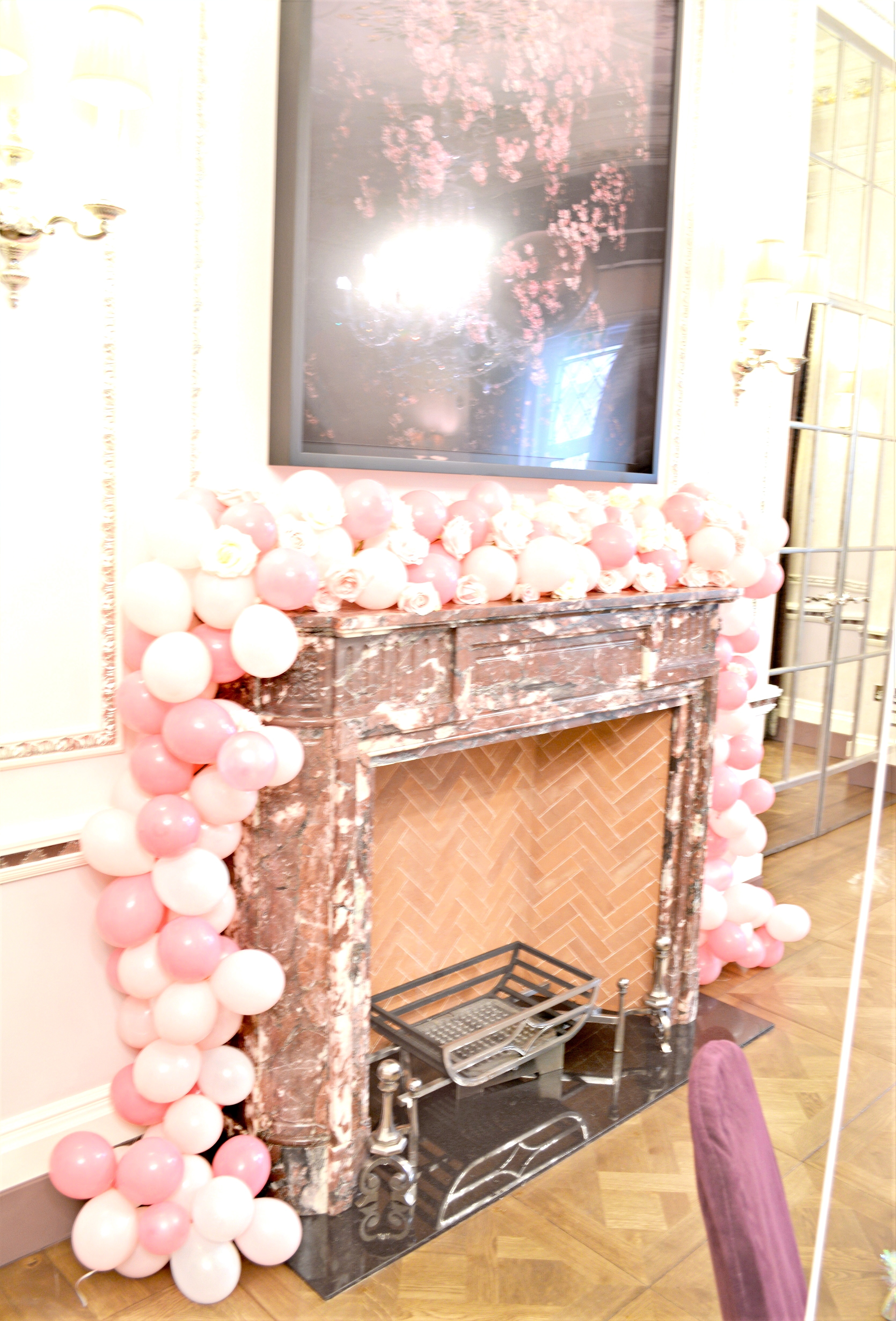 Pink, White and Rose Gold Themed Birthday Wedding Cake, Flower Runner Arrangements and Balloon Garland Fireplace at The Connaught London Cherie Kelly