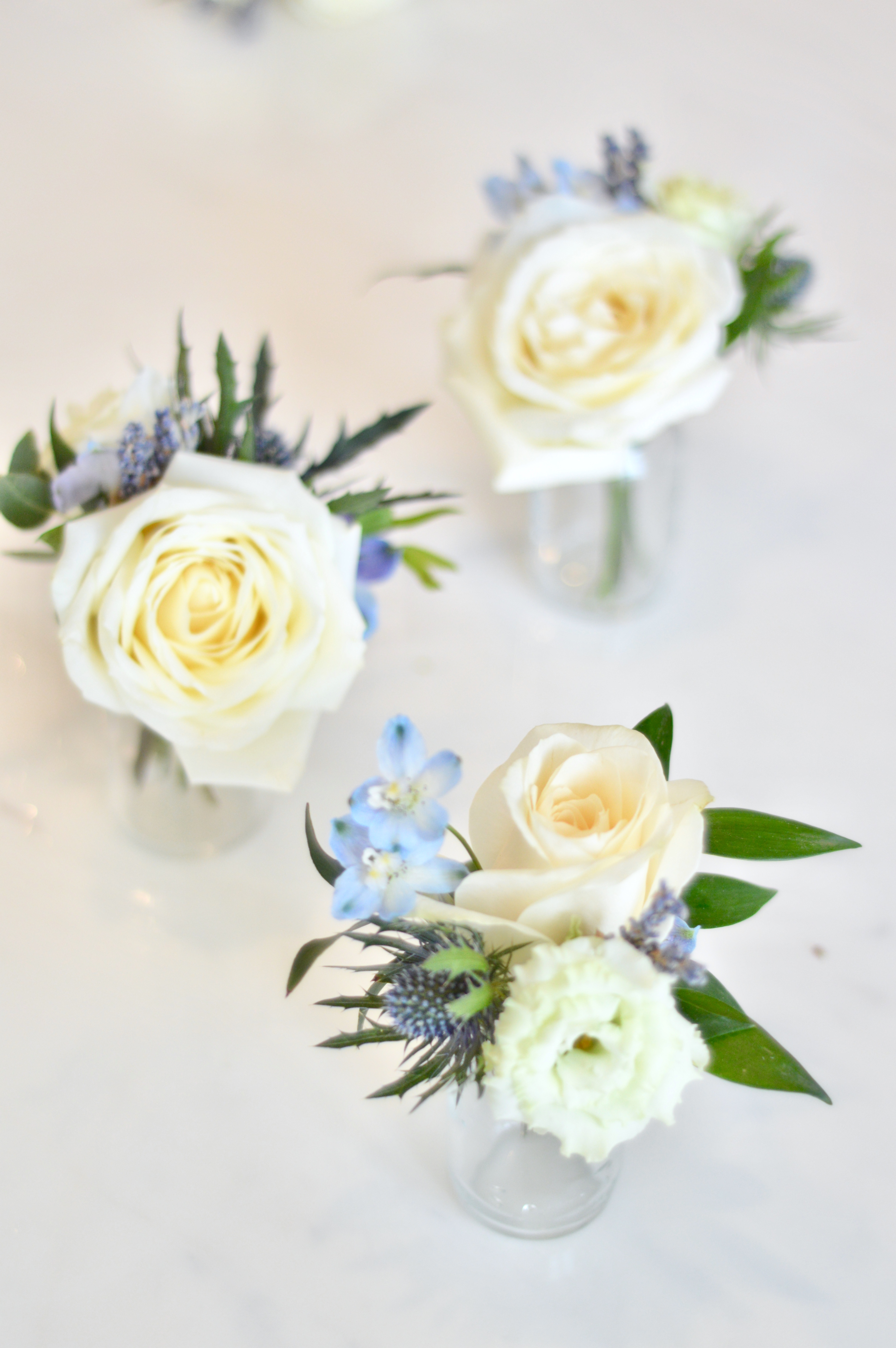 Rustic pink and blue Roses, Thistle, Lisianthus, Peonies, David Austin roses, Delphinium and foliage buttonhole Cherie Kelly flowers London