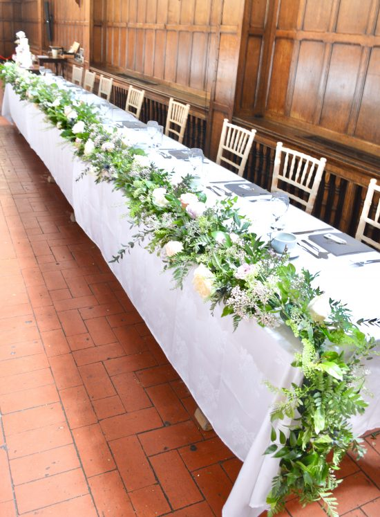 Rustic pink and blue Roses, Thistle, Lisianthus, Peonies, David Austin roses, Delphinium and foliage headtable garland Cherie Kelly flowers London