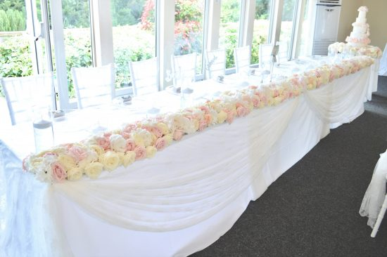 Luxury Blush Pink and White Wedding Flowers and Cake at Hunton Park Peony Hydrangeas and Roses Headtable toptable flower runner with floating candles Cherie Kelly Cake London