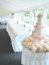 Luxury Blush Pink and White Wedding Flowers and Cake at Hunton Park Peony Hydrangeas and Roses Headtable toptable flower runner with floating candles Cherie Kelly Wedding Cake London