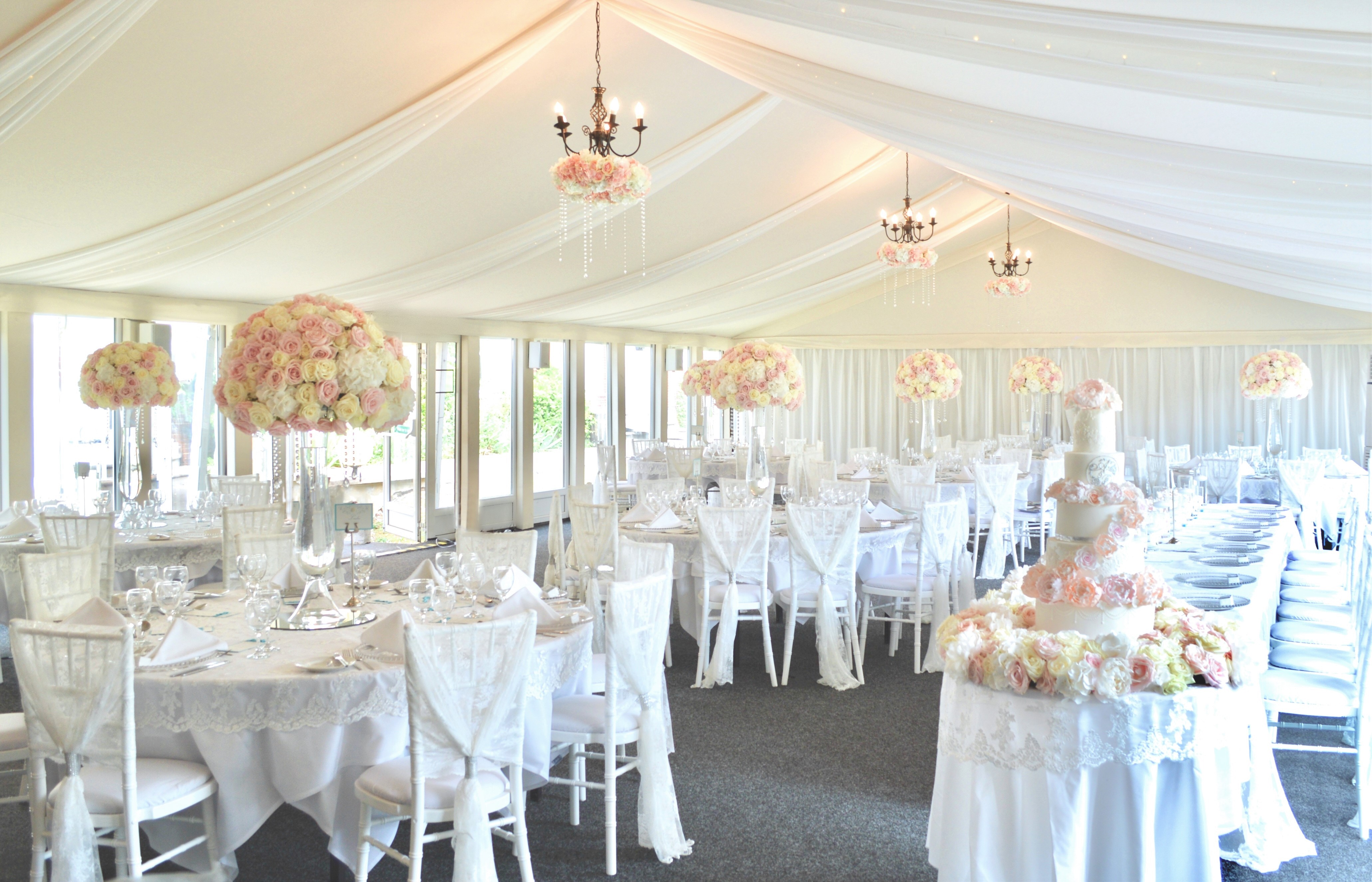 Luxury Blush Pink and White Wedding Flowers and Cake at Hunton Park Peony Hydrangeas and Roses Tall Vase Centrepieces with Crystals and Floral Chandelier Cherie Kelly 6 Tier Wedding Cake London.jpg