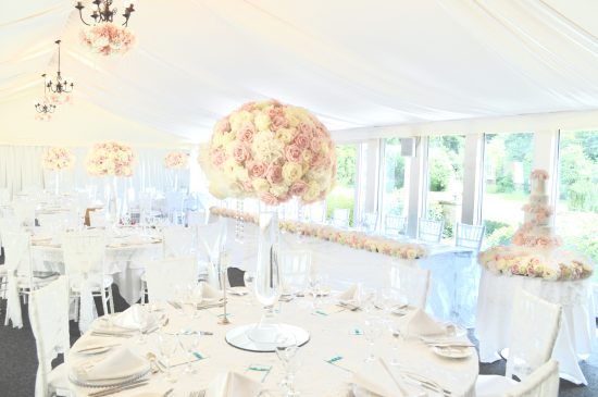 Luxury Blush Pink and White Wedding Flowers and Cake at Hunton Park Peony Hydrangeas and Roses Tall Vase Centrepieces with Crystals and Floral Chandelier Cherie Kelly Cake London 1