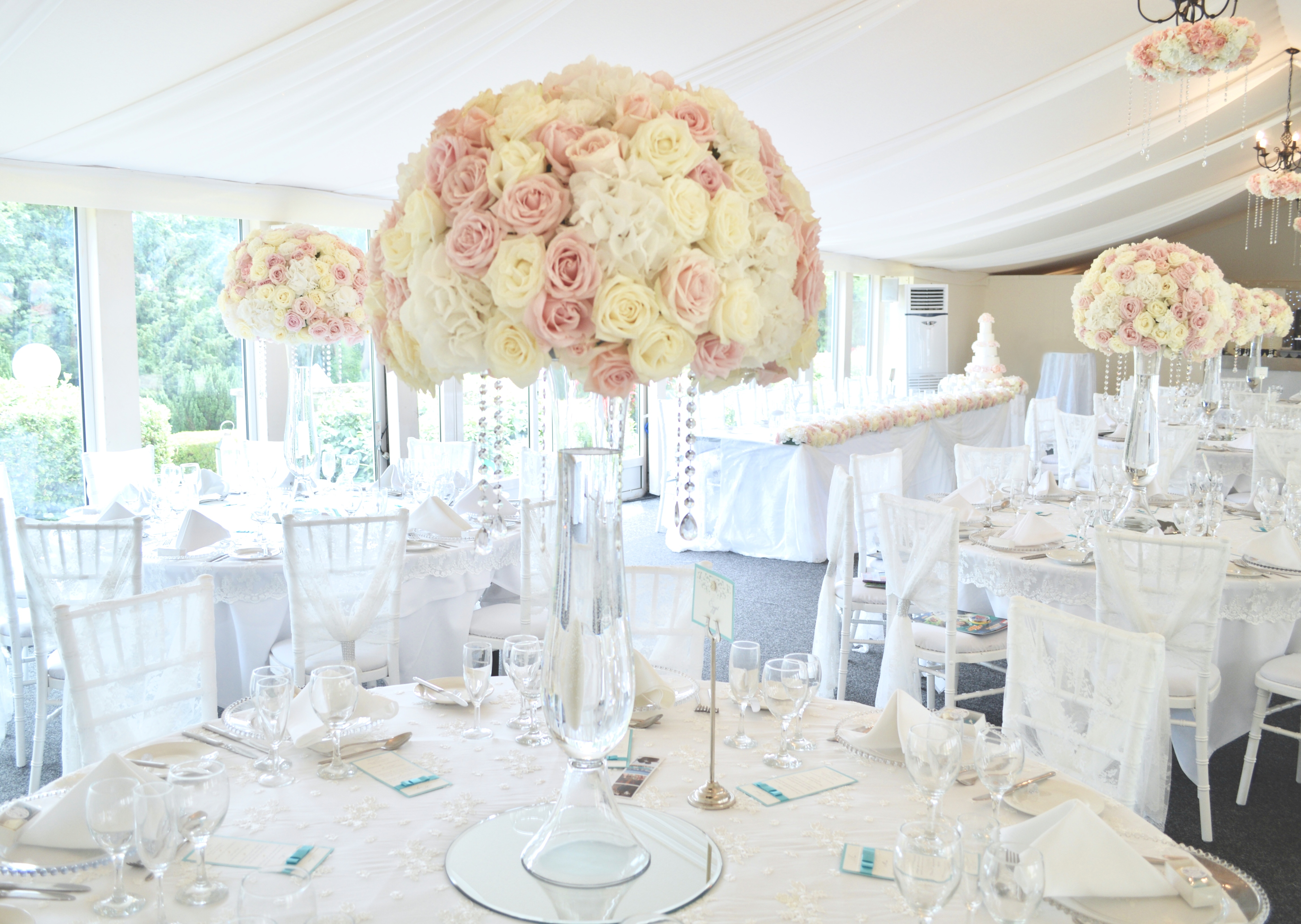 Luxury Blush Pink and White Wedding Flowers and Cake at Hunton Park Peony Hydrangeas and Roses Tall Vase Centrepieces with Crystals and Floral Chandelier Cherie Kelly Cake London 4