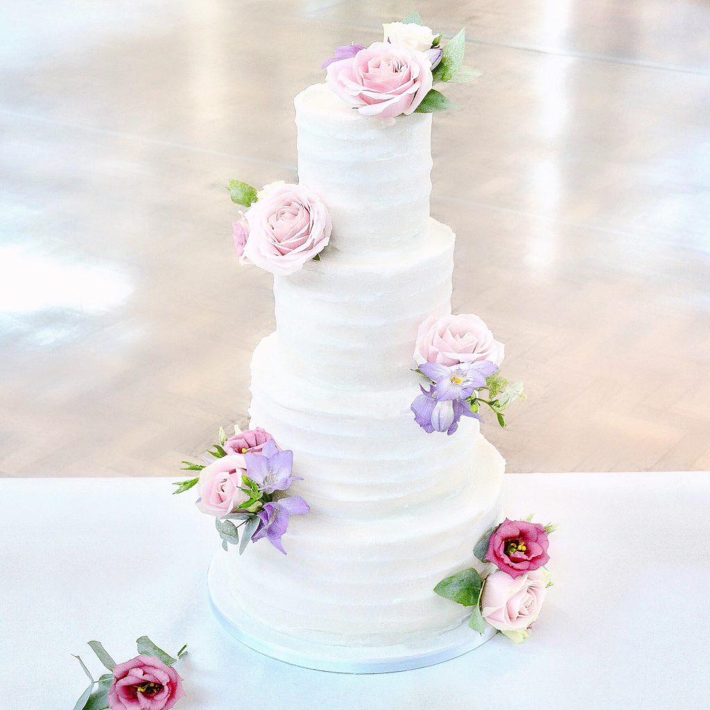 4 Tier Pink Lilac Roses freesia and lisianthus rustic buttercream wedding cake Cambridge Cherie Kelly cakes London