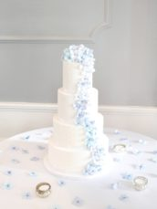4 Tier Wedding cake with cascade of blue hydrangeas sugar flowers Cherie Kelly cakes London