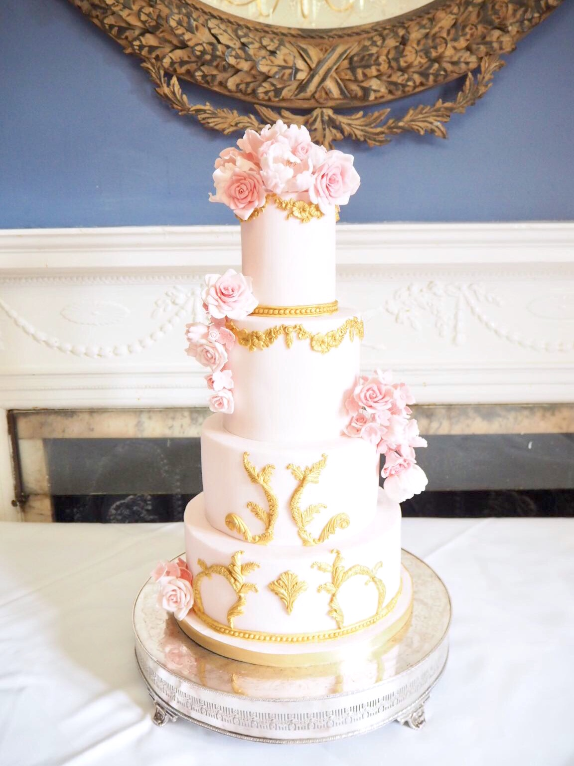 4 tier pink and gold wedding cake with sugar flowers and baroque moulding details wedding cake Cherie Kelly cakes London