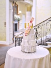 6 Tier marble pattern and gold leaf wedding cake with cascade roses and peonies Hedsor House Cherie Kelly cakes London