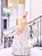6 Tier marble pattern and gold leaf wedding cake with flower cascade roses and peonies Hedsor House Cherie Kelly cakes London