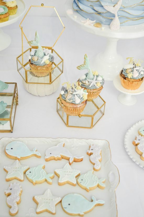 Under the sea themed birthday party cake dessert table cookies mermaid cakepops cupcakes Cherie Kelly cakes London