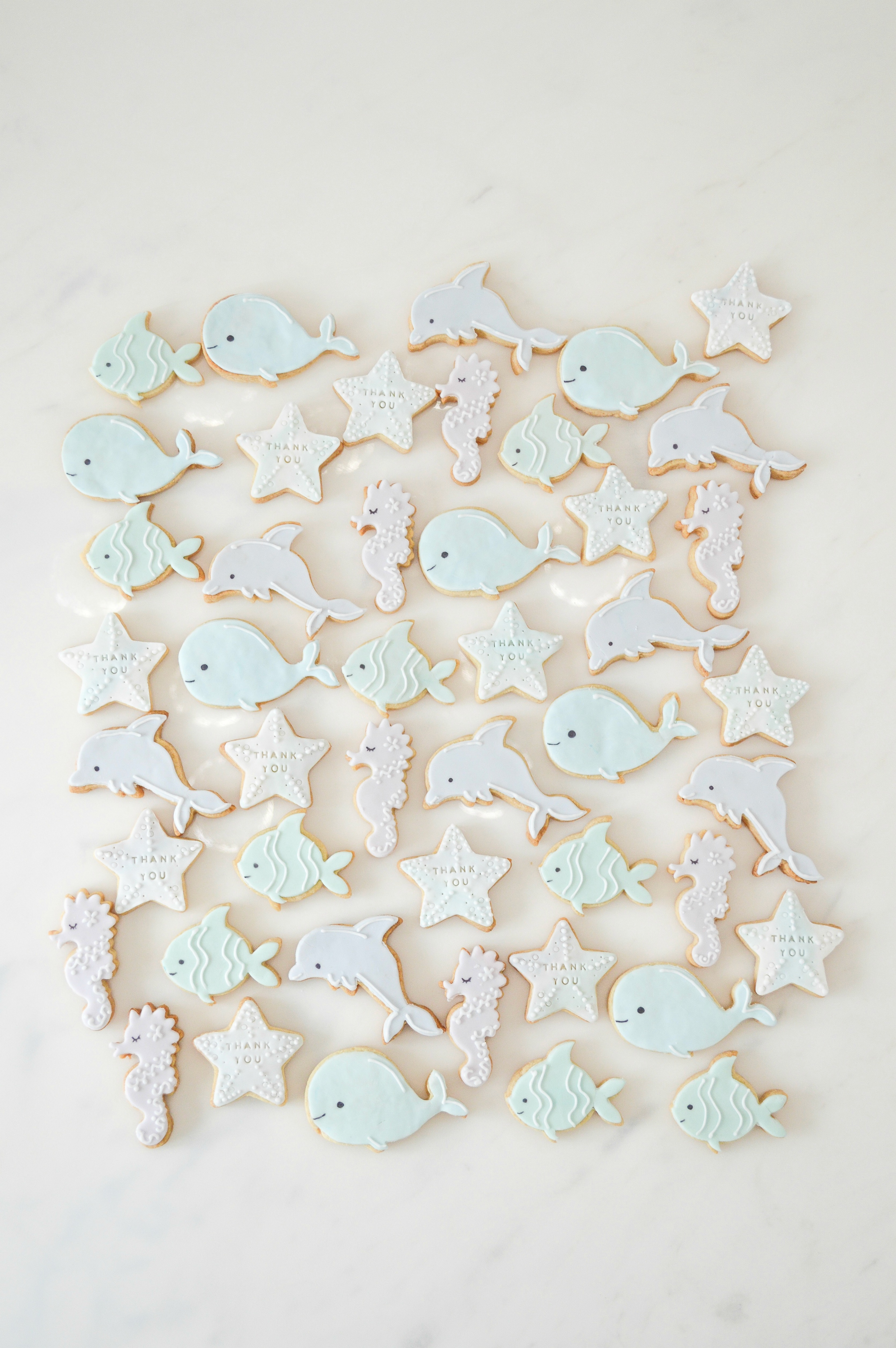 Under the sea themed birthday party cookies mermaid stairfish seahorse whale fish dolphin Cherie Kelly cakes