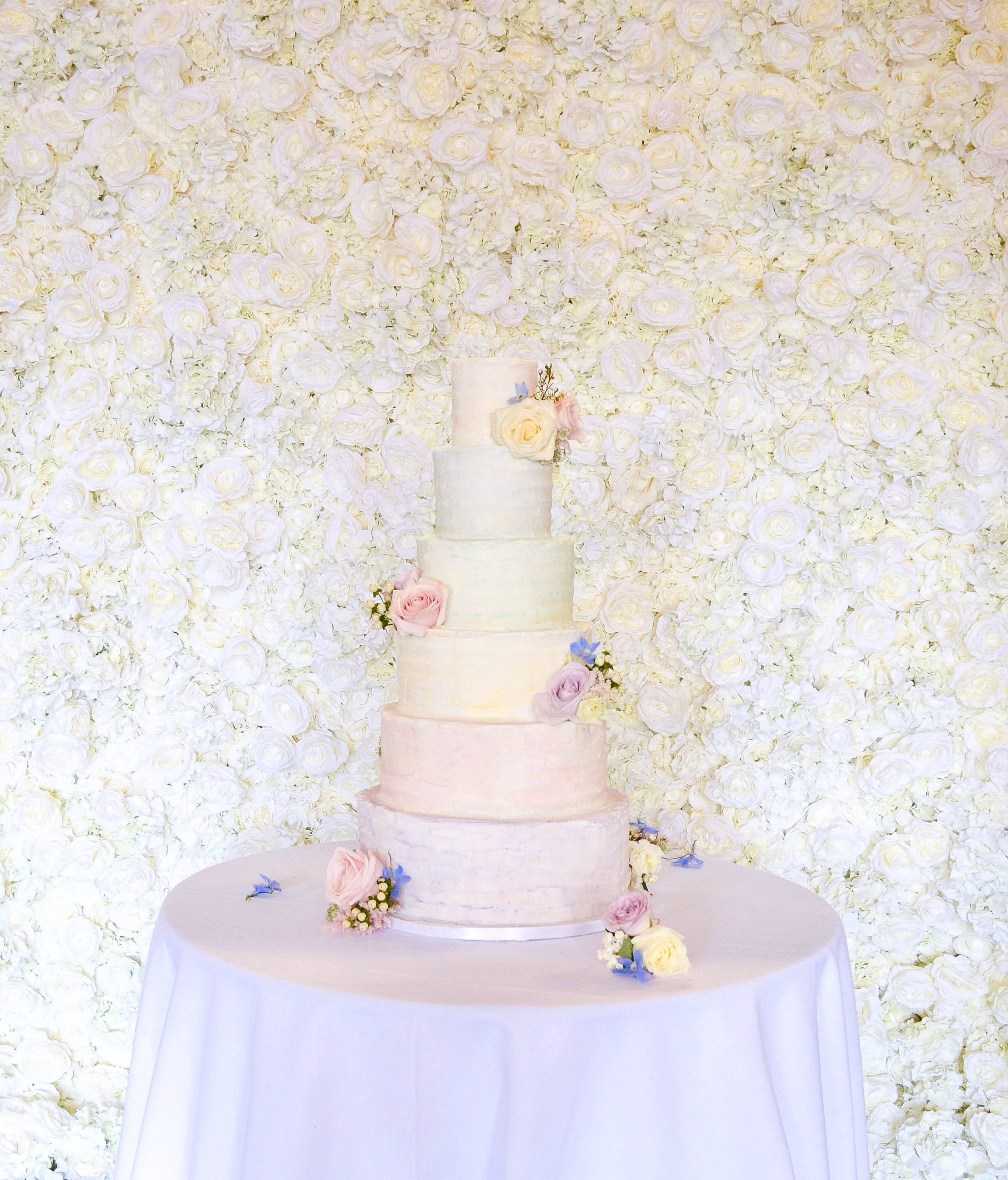6 Tier Pink Lilac Roses freesia and lisianthus watercolour rustic buttercream wedding cake flower wall hire Dulwich College Cherie Kelly London