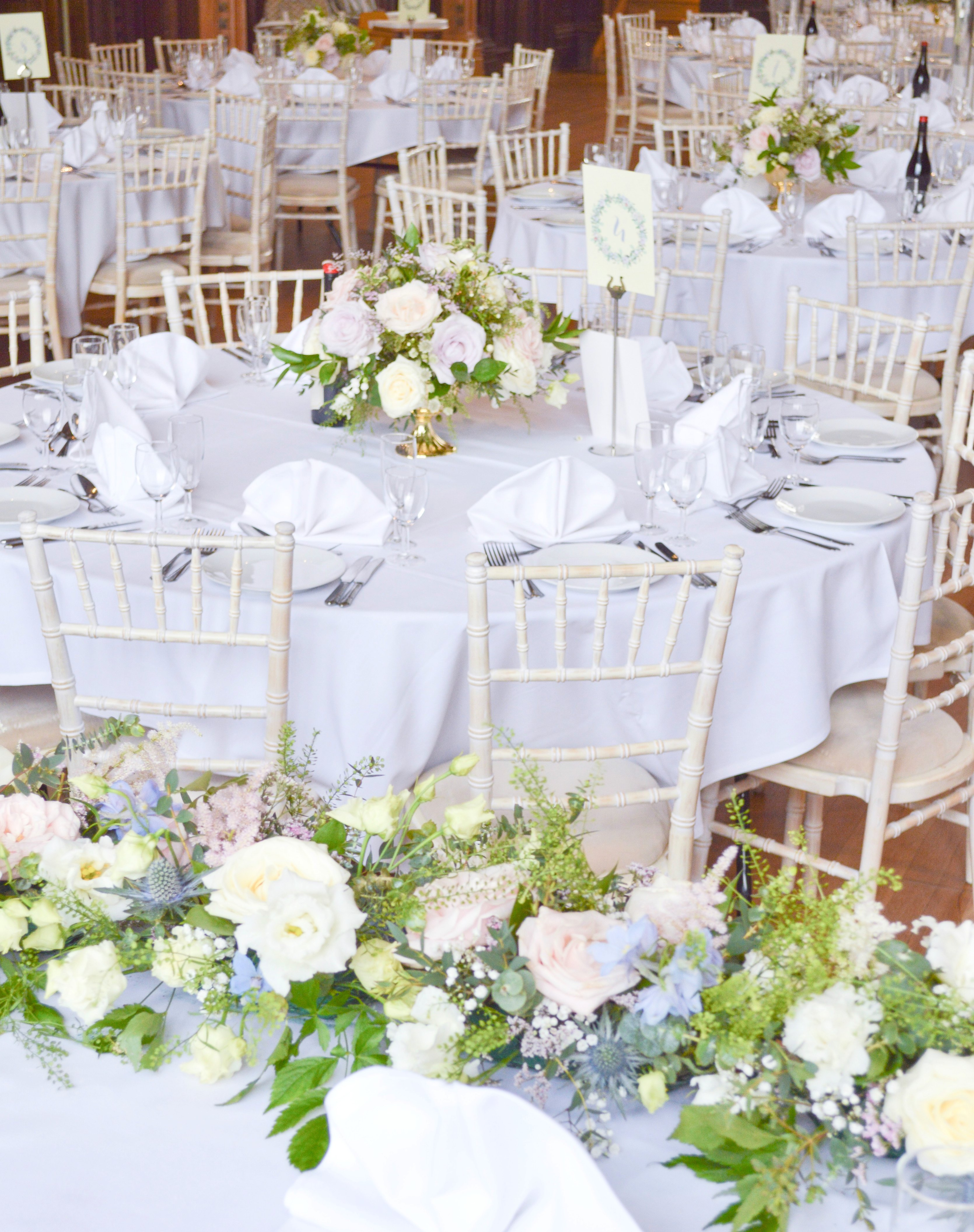 Natural garden rustic style spring pastel pink blue lilac head top table flower garland wedding reception centrepieces Dulwich College Cherie Kelly wedding flowers London