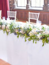 Natural garden rustic style spring pastel pink blue lilac head top table flower garland wedding reception floral arrangement Dulwich College Cherie Kelly wedding flowers London