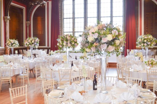 Natural garden rustic style spring pastel pink blue lilac high and low table centrepieces floral arrangement wedding reception Dulwich College Cherie Kelly wedding flowers London 1