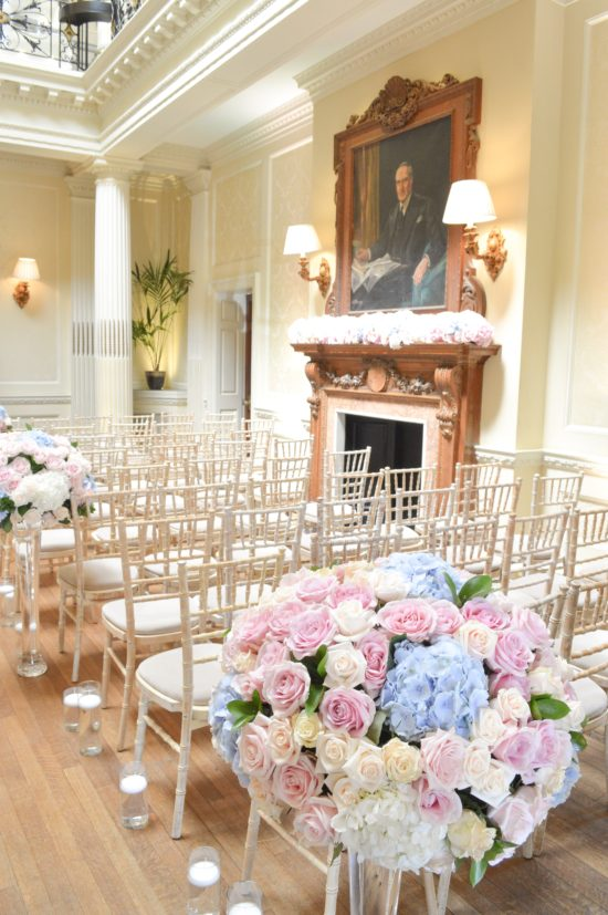 Dusty blue and pink wedding fireplace arrangement wedding ceremony aisle tall centrepieces Cherie Kelly cakes London Hedsor House
