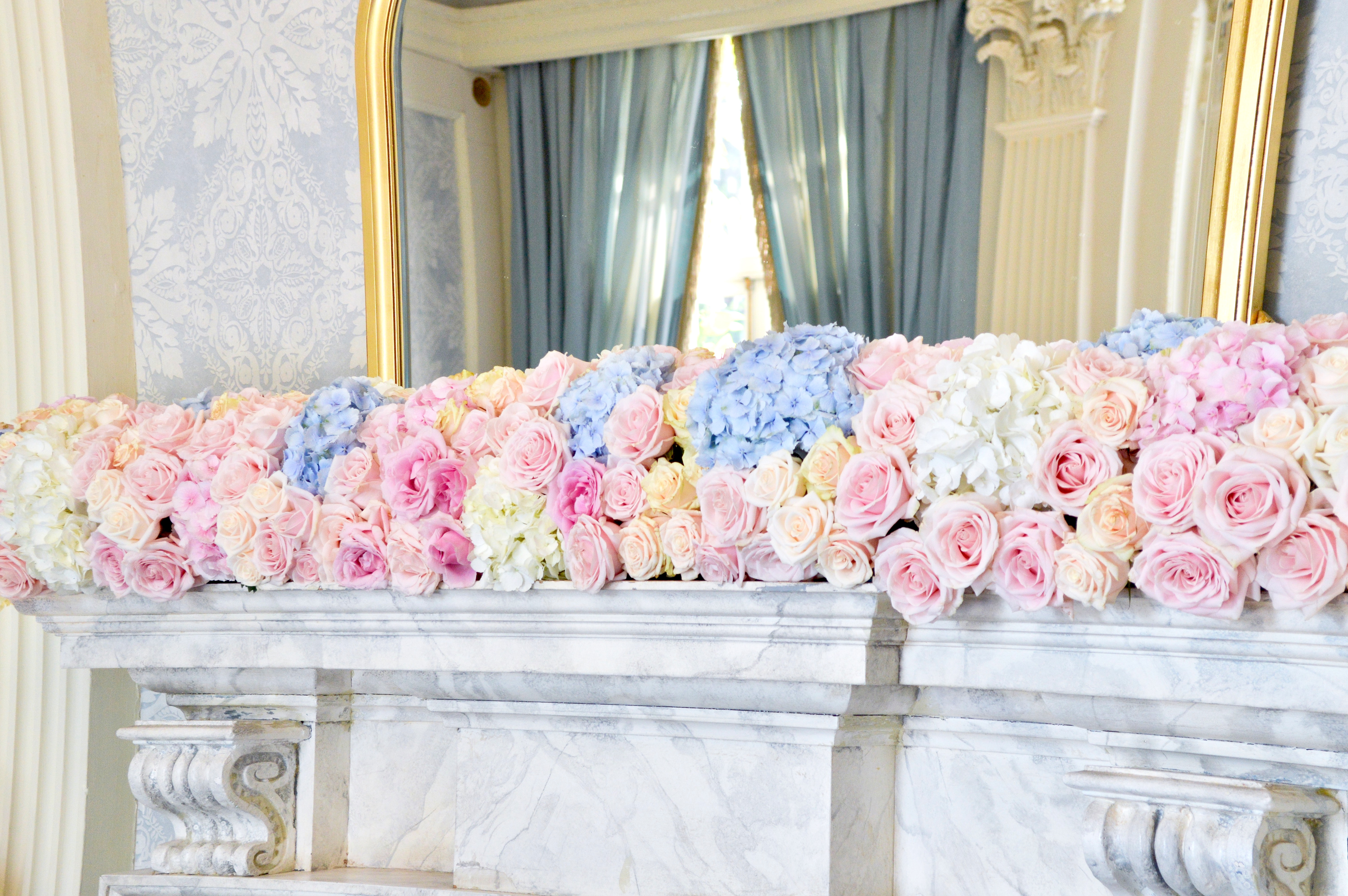 Dusty blue and pink wedding fireplace arrangements wedding ceremony aisle tall centrepieces Cherie Kelly cakes London Hedsor House 3