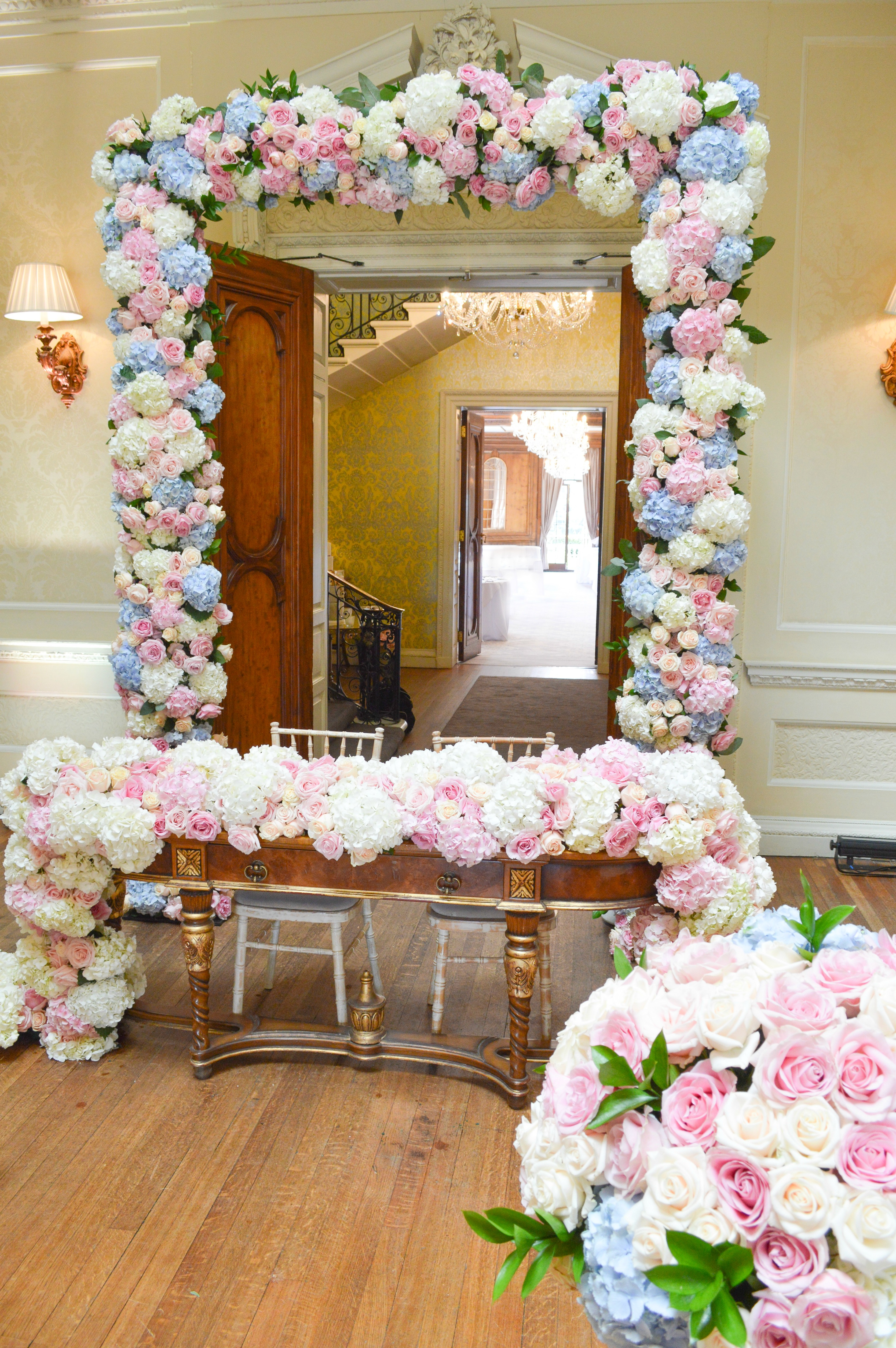 Dusty blue and pink wedding flower arch registrar table head toptable floral garland wedding ceremony aisle tall centrepieces Cherie Kelly cakes London Hedsor House 2
