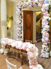 Dusty blue and pink wedding flower arch registrar table head toptable floral garland wedding ceremony aisle tall centrepieces Cherie Kelly cakes London Hedsor House 3