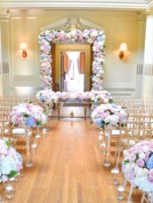 Dusty blue and pink wedding flowers arch registrar table head toptable floral garland wedding ceremony aisle Cherie Kelly cakes London Hedsor House 0
