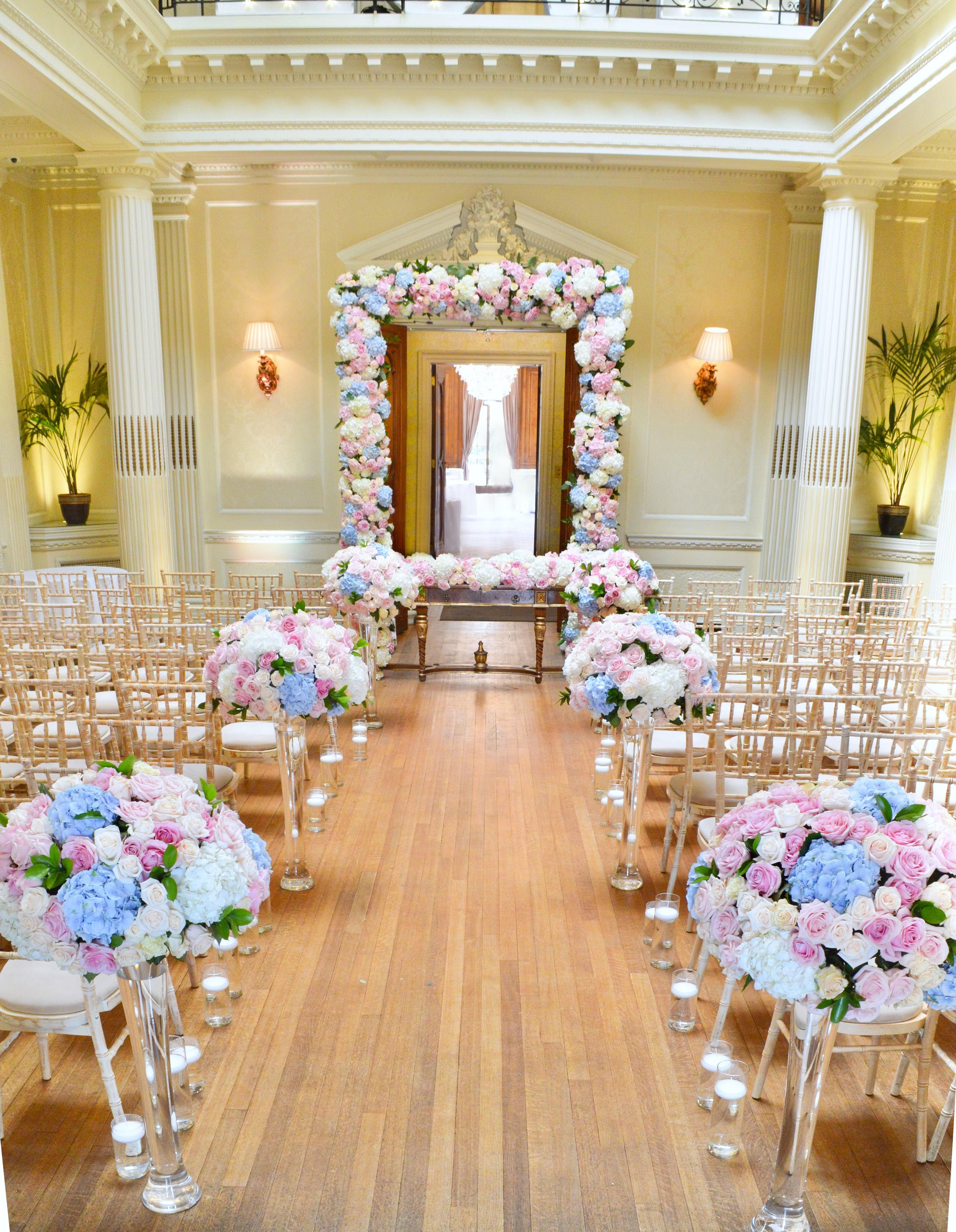 Dusty blue and pink wedding flowers arch registrar table head toptable floral garland wedding ceremony aisle Cherie Kelly cakes London Hedsor House 1