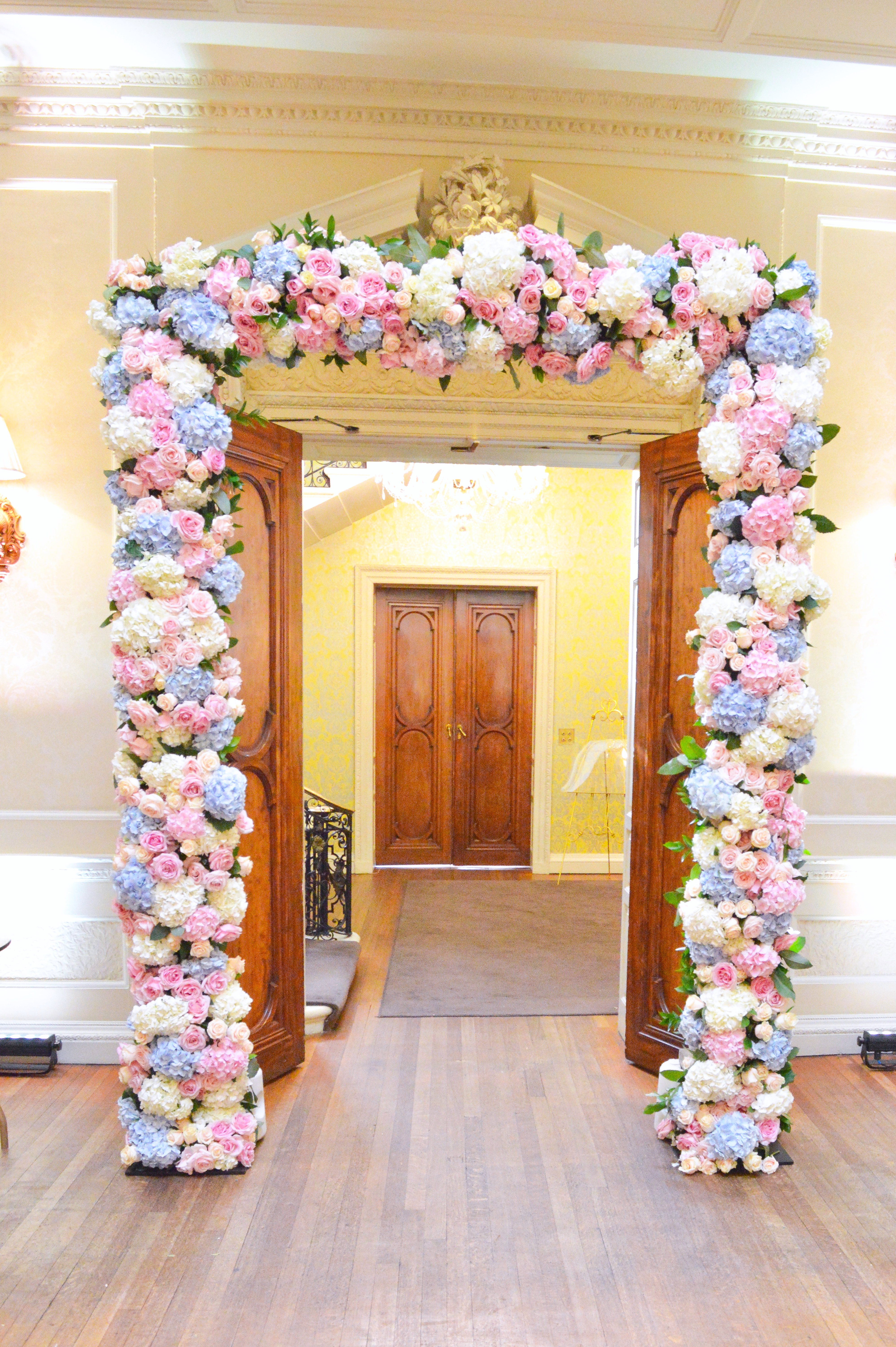 Dusty blue and pink wedding flowers arch registrar table head toptable floral garland wedding ceremony aisle Cherie Kelly cakes London Hedsor House (2)