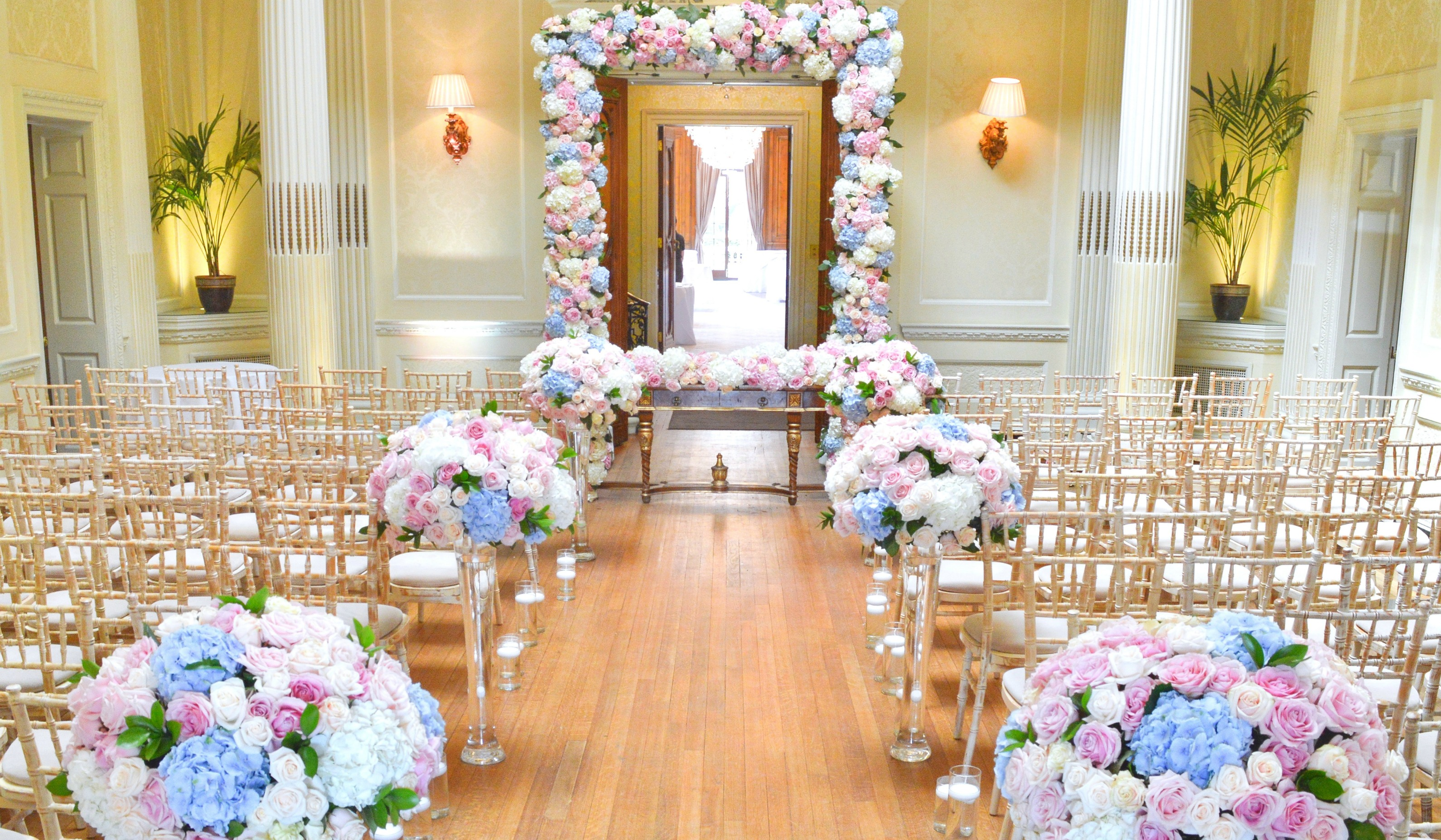Dusty blue and pink wedding flowers arch registrar table head toptable floral garland wedding ceremony aisle Cherie Kelly cakes London Hedsor House Wedding