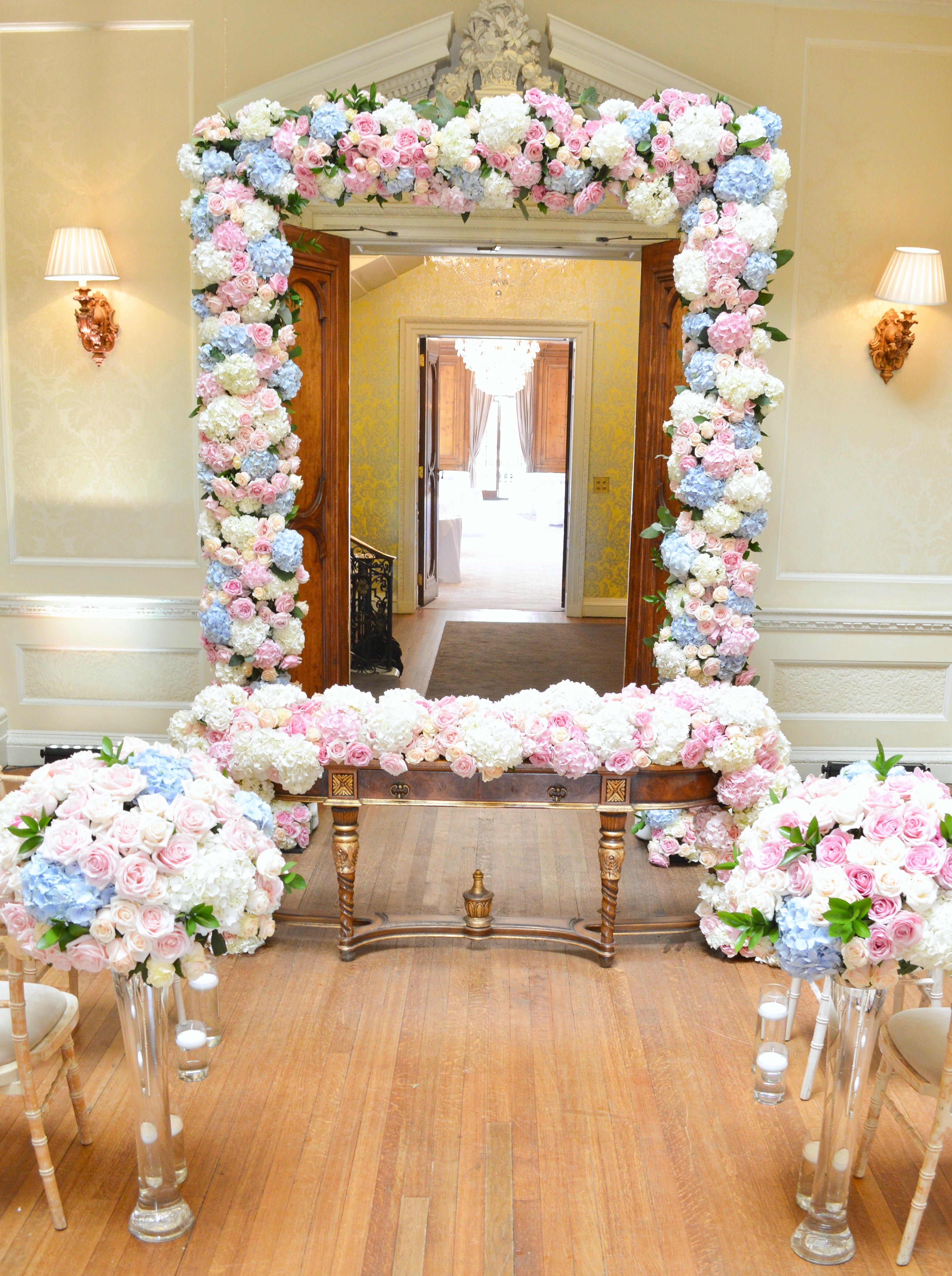 Dusty blue and pink wedding flowers arch registrar table head toptable floral garland wedding ceremony aisle Cherie Kelly cakes London Hedsor House