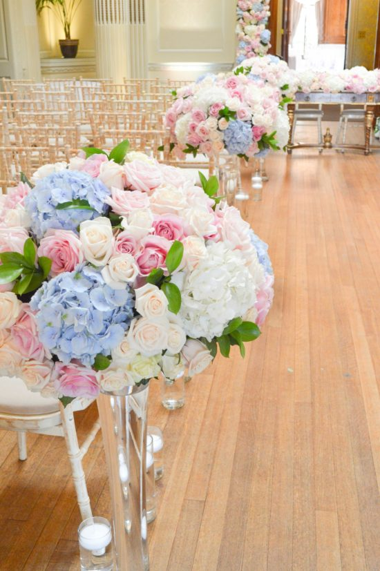 Dusty blue and pink wedding flowers arch registrar table head toptable floral garland wedding ceremony aisle tall centrepieces Cherie Kelly cakes London Hedsor House 3