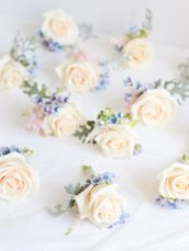Dusty blue and pink wedding flowers bottonholes Cherie Kelly London Hedsor House
